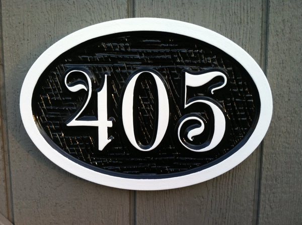 House number sign with whimsical font