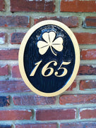 3 digit house number with fancy font and shamrock easy to read black and gold color scheme
