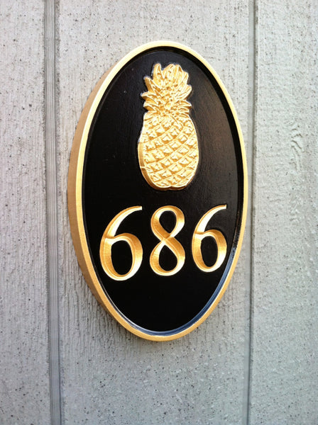 Oval house number sign with welcome pineapple black and gold