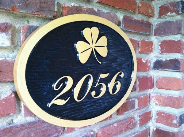 custom carved house number sign with 2056 shamrock painted black and gold