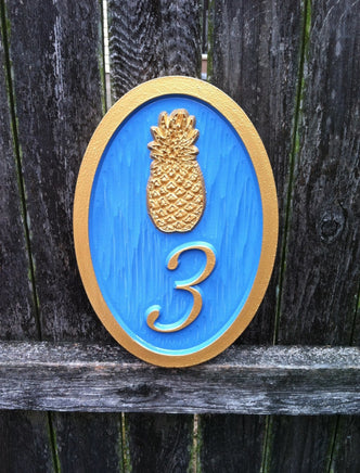 House number sign with bright paint scheme