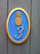 1 digit house number sign with bright blue and gold colors