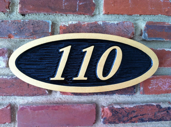 Oval house number sign with textured background italic number- front