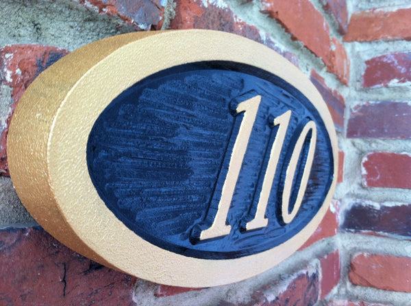 Oval house number sign with textured background italic number- iso