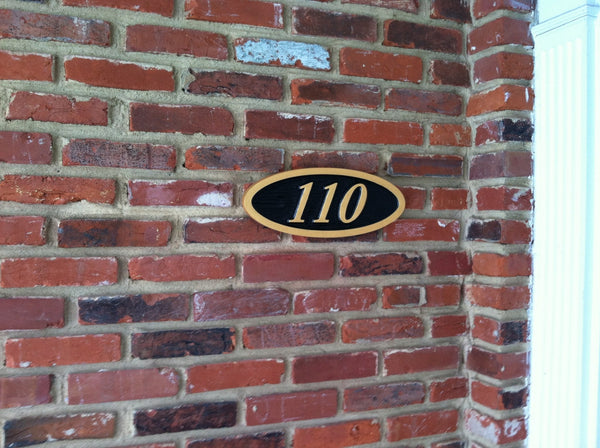 Oval house number sign with textured background italic number- iso2