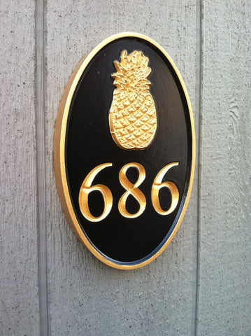 Oval house number sign with pineapple