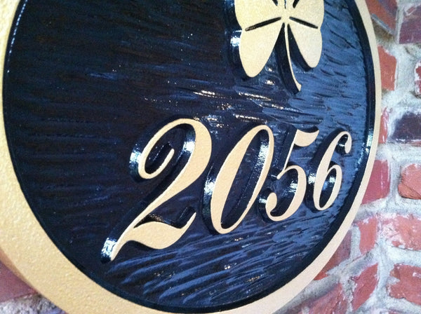 4 digit house number sign with shamrock close up
