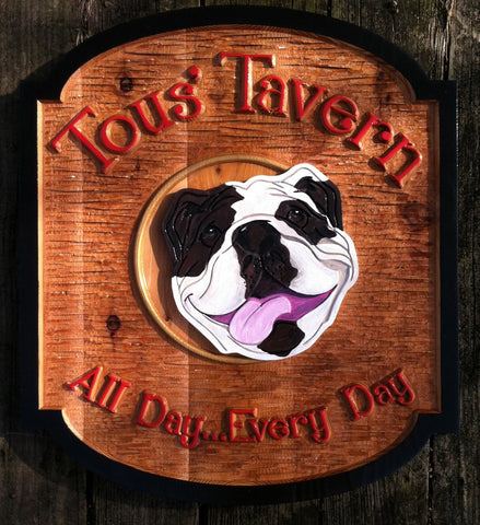 Cedar Tavern sign with bulldog in center black border red letters