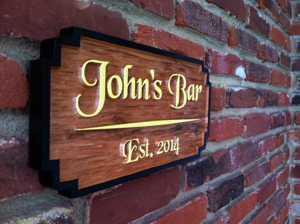 Custom carved cedar bar sign with first name and est date