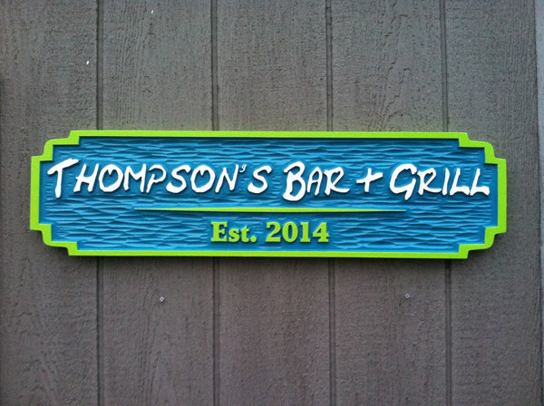 Thompson's bar and grill sign front view painted blue lime green and white
