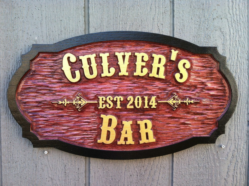 Carved cedar bar sign with western theme font and established date
