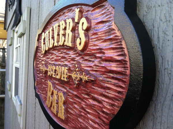 Old west themed cedar bar sign with stained background and gold letters