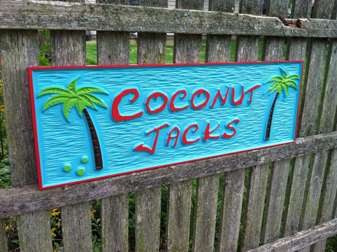 Tiki bar sign with coconut trees