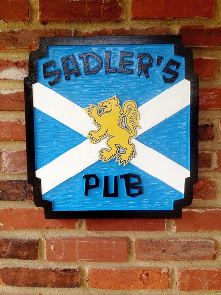 Pub sign with last name and Scottish fighting lion