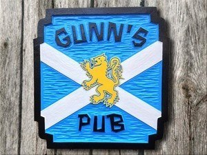 Scottish theme pub sign with last name and lion image