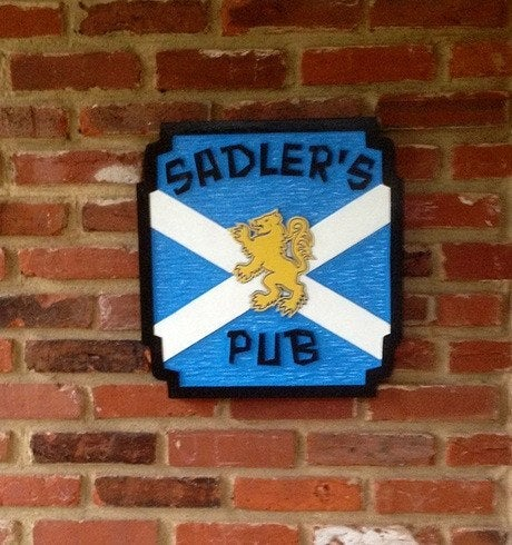 Scottish lion pub sign with last name and flag