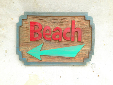 distressed beach sign with arrow - front
