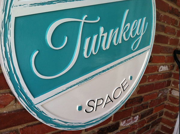 Turnkey Retail Business sign carved by The Carving Company -iso3
