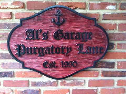 Cedar address sign for Als Garage