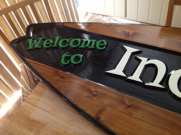 Cedar surfboard sign with estate name -iso