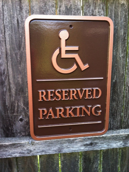 Parking sign with business logo - handicap reserved parking