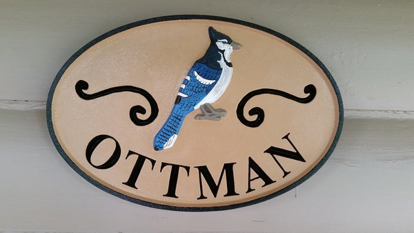 Oval last name sign with blue jay and scrolls