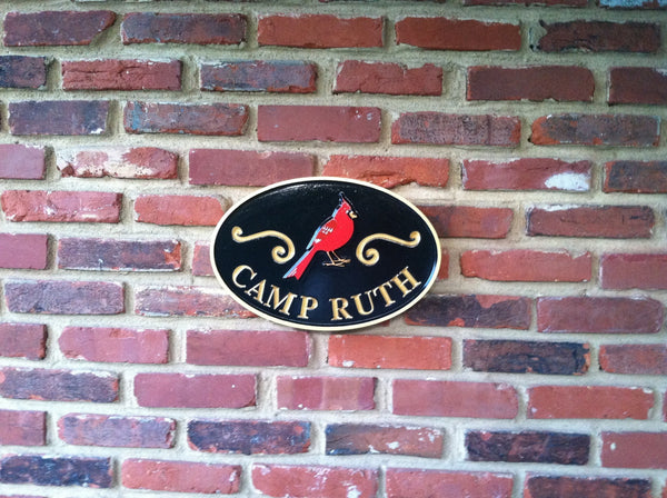 Oval camp name sign with cardinal and classic scrolls