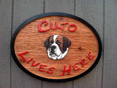 Cujo lives here Beware of Dog stained sign with St. Bernard painted in center