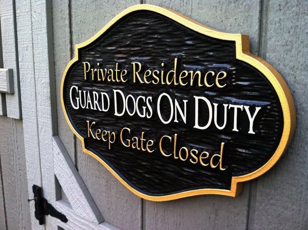 Private residence guard dogs on duty sign