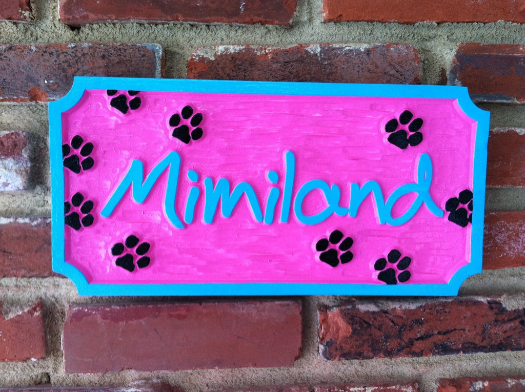 Single name pet sign with paw prints bright colors