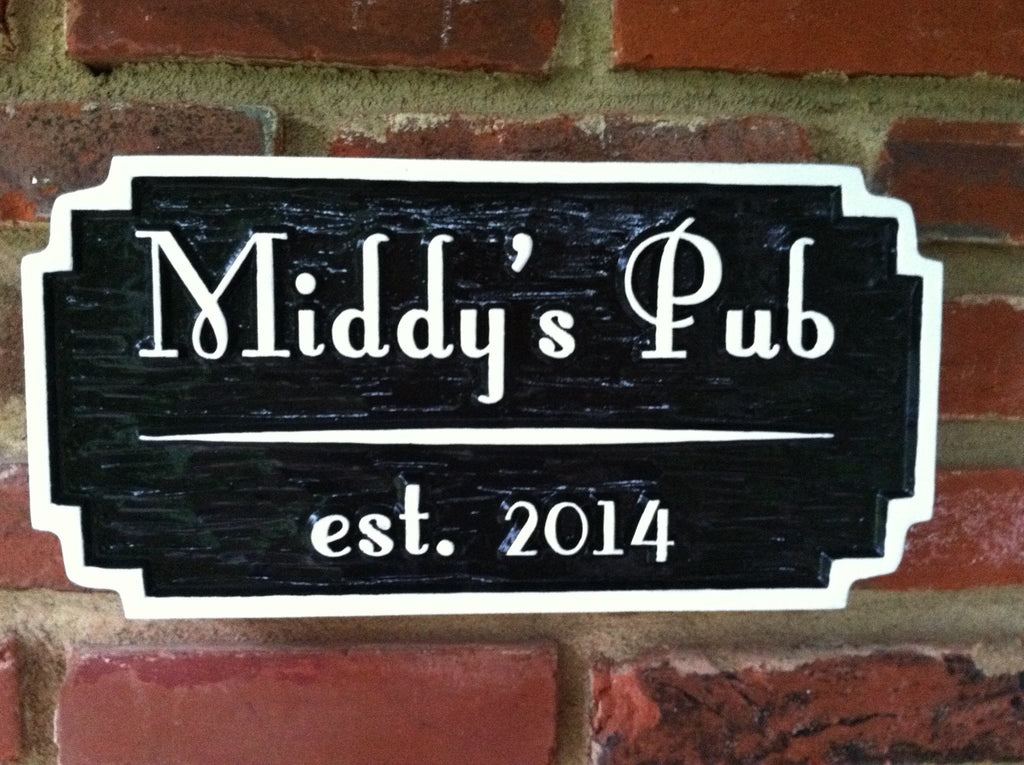 Custom carved pub sign painted black and white