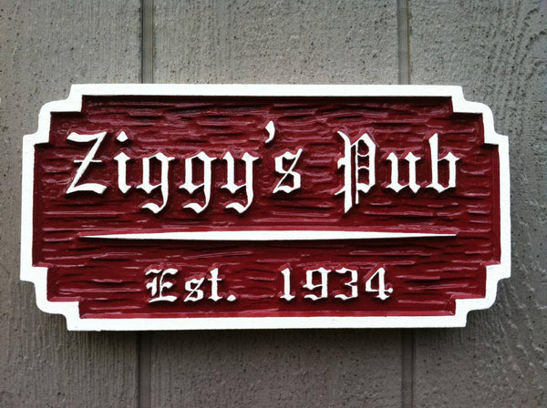 Old English style pub with painted red and white with established year
