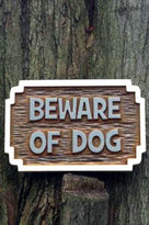 Beware of dog sign in carved cedar front view