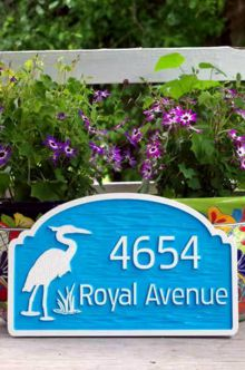 Address sign with heron sky blue and white front view