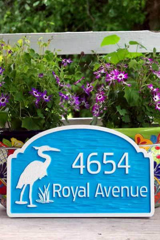 Address sign with blue heron, front view
