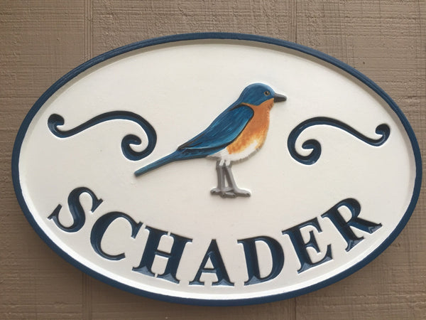 Family name sign for home with painted blue bird