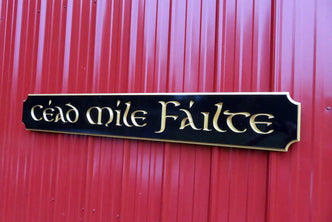 Cead Mile Failte quarterboard sign with gaelic theme