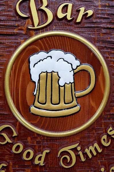 close up of beer mug with frothy top carved on cedar sign