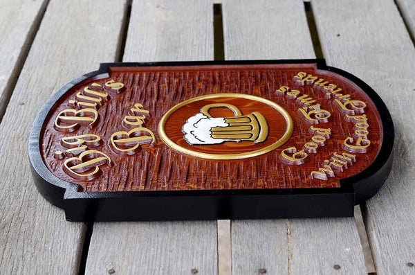 Side view of carved wooden bar sign with gold letters black border and beer mug image