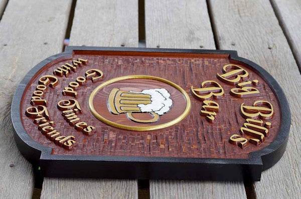 right side view of carved wooden bar sign with gold letters black border and beer mug image