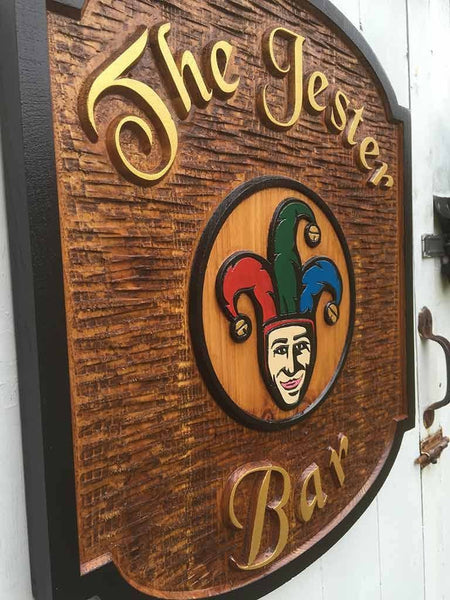 Side view of Cedar Bar Sign with Jester Image and black border