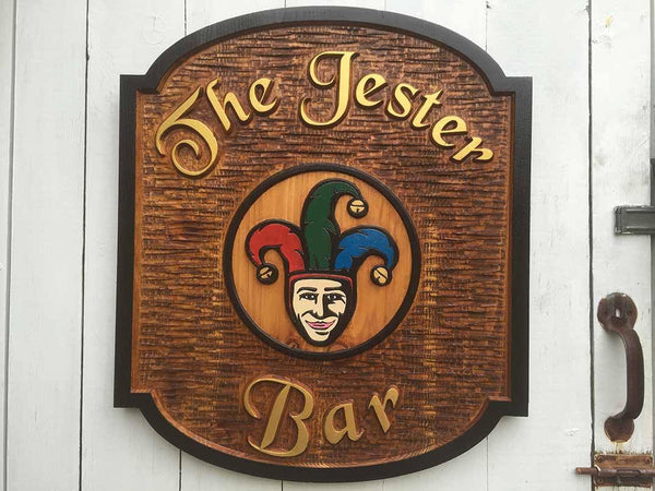Custom Carve Cedar Bar Sign with Jester Image and black border hanging on door
