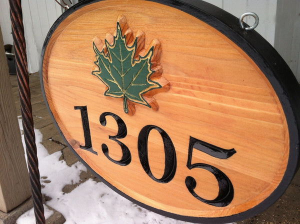 Oval cedar house number sign with maple leaf