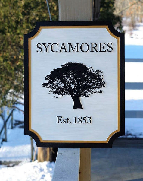 Custom carved entrance sign with sycamore tree and established date