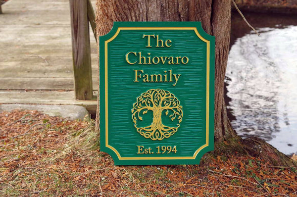 Custom carved entrance sign with tree and established date