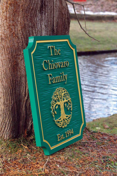 Side view of Custom carved entrance sign with tree and established date painted green and gold