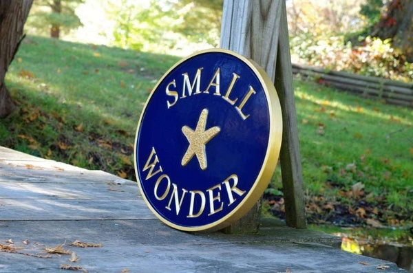Side view of House name sign with starfish painted navy blue and gold