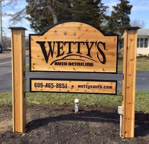Wetty's Auto Detailing cedar carved double sided sign mounted on posts carved by The Carving Company