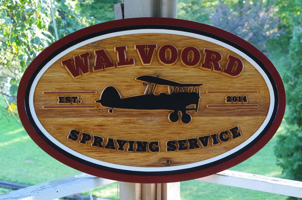 Custom carved cedar business sign with airplane
