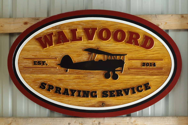 Custom carved cedar business sign with crop duster airplane